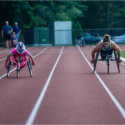 Maddie Wilson and her mentor, champion wheelchair racer, Tatyana McFadden at the race track