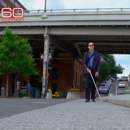 Architect Chris Downey walking on the street with his cane