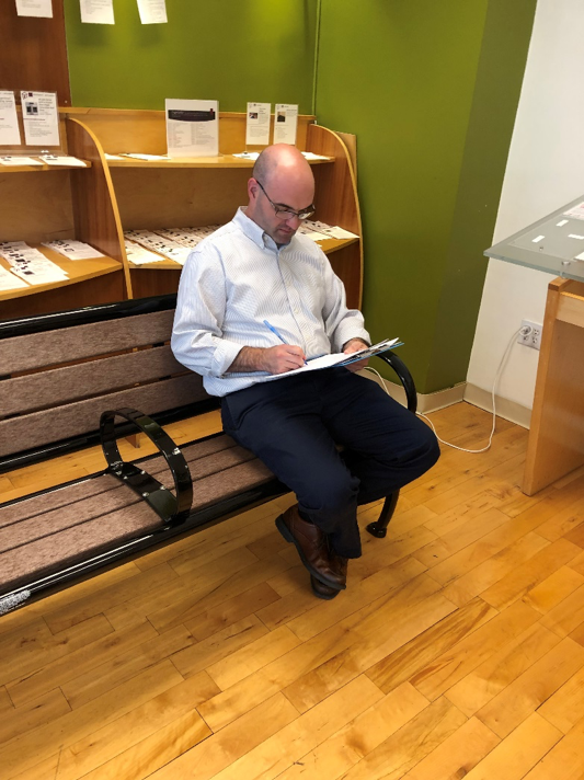 An MBTA stakeholder reviewing one of the benches in the study.