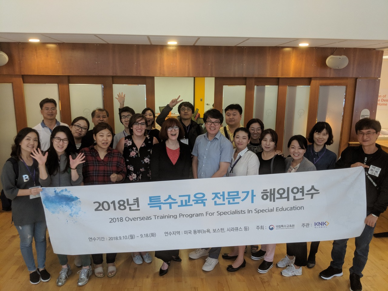 Group of Korean visitors at IHCD office with Valerie and intern Ariel for 2018 Overseas Training Program for Specialists in Special Education
