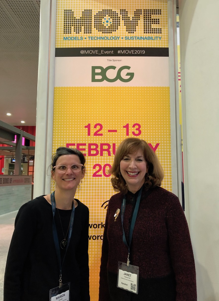 Jan Carpman and Marion Decaillet pose with a banner at the MOVE Conference in London