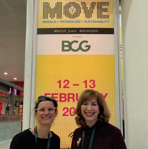 Jan Carpman and Marion Decaillet pose with a conference banner at the MOVE Conference in London