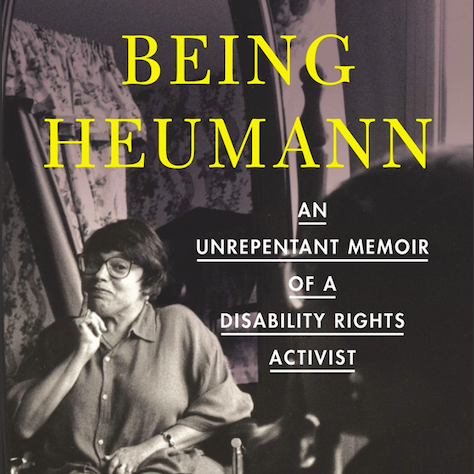 Book Cover of Being Heumann: An Unrepentant Memoir of a Disability Rights Activist shows Judy seated with a smile